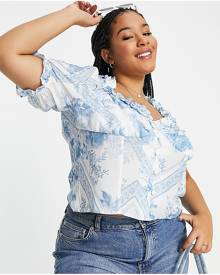 River Island Plus ripped raw hem high-rise skinny jeans in mid auth blue