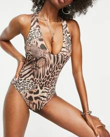 ASOS DESIGN oversized bomber jacket in black with gold back placement embroidery