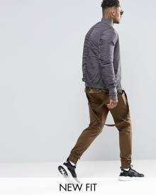 ASOS Skinny Joggers With Rear Taping Detail And Woven Pockets In Khaki - Green