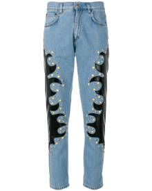 Moschino - studded patch straight jeans - women - Cotton/Polyester/Polyurethane - 40, 42, 38 - BLUE