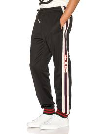 Gucci Technical Jersey Pant in Black & Ivory & Live Red - Black,Stripes. Size M (also in S).