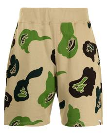A BATHING APE® camouflage-print track shorts - Brown