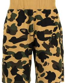 A BATHING APE® camouflage-print cotton track shorts - Brown