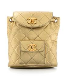 Chanel Pre-Owned 1991-1994 metallic flap drawstring backpack - Gold